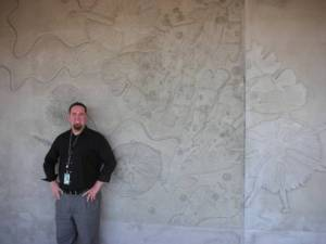 Ambassablogger Ryan is dwarfed by a dramatic artistic branding statement about natural San Diego. Where is this at the airport? Submit your answer using the comments link at the bottom of the post.