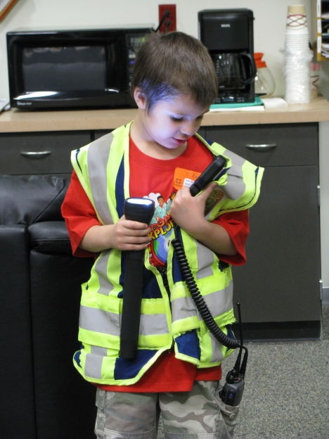 Ben tries on an Airport Traffic Officer's uniform for size.